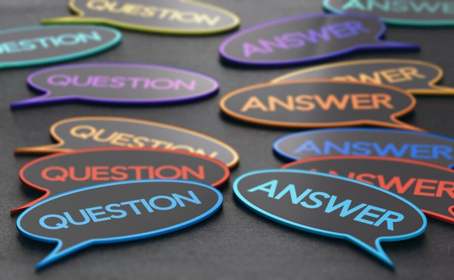 "Photograph of speech bubbles with the words ""Question"" in some of them and ""Answer"" in others on a dark surface."